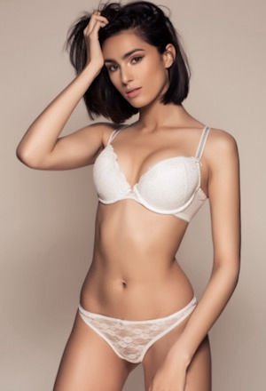 Slim brunette escort in white lingerie